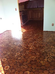 Sunny Pettis Lutz  sent some photos of her gorgeous, hand-made cordwood floor.  The following is a detailed list of how they made their floor with legal pickings from the state forest...