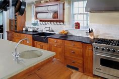 Like: cabinets , hardware, soapstone, subway tile, sink & faucet, hood over range, island with storage, microwave drawer, seating.