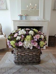 Centerpiece with silk flowers in basket