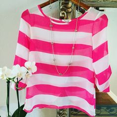 Sheer Pink Striped Top This shirt is sheer so you will need a camisole to wear underneath. The back is fly away/open also. Really great top for a causal day or night out! Only worn once! Apricot Lane Tops Blouses
