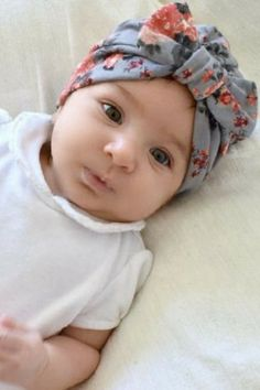 This trendy little grey floral turban hat for girls is a sweet accessory for any baby, age approximately 3-18 months. These cotton turban hats are soft and cozy, and make a stylish addition to any outfit. These baby turban hats come with a cute bow and a beautiful floral print, making them a wonderful gift that any fashionista would love. #babyturban #babygirlturban #babyturbanhat #babygirl #cutebabygirl #babygirlfashion #trendybaby #trendybabygirl #babyfashion #babyheadband #babyheadwrap