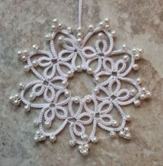 25 Motif Challenge: Marie has liked working in pearls so much she did a few more snowflakes. This pearly flower is from Occhi peacock book.Gwen tatted Snowflake from Festive Snowflakes and Ornaments by Barbara Foster in Lizbeth size 20 white. Tatting Earrings, Tatting Jewelry, Tatting Lace, Shuttle Tatting Patterns, Needle Tatting Patterns, Lace Patterns, Crochet Patterns, Tatting Tutorial, Crochet Snowflakes