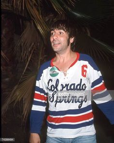 Keith Moon of the rock and roll band 'The Who' attends an event wearing a jersey that reads 'Colorado Springs' on it in circa 1975