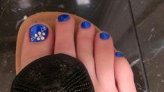 Royal blue nail with a white flower design
