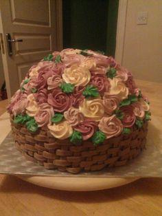 Sweet cream basket full of flowers