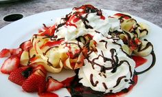 Palacinky (Crepes) with jam or fruit on the inside with whipped cream ...