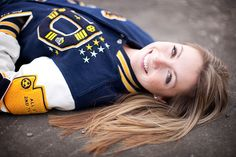 Senior sport photo. Love how it shows off the letter jacket.