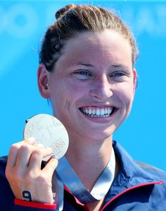 Haley Anderson of USA poses with her gold medal after winning the Open Water Swimming Women's 5k race on day one of the 15th FINA World Championships at Moll de la Fusta on July 20, 2013 in Barcelona, Spain.