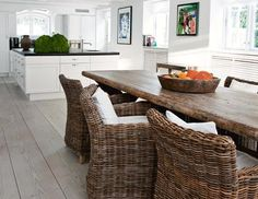 Beautiful wicker chairs and rustic dining table.