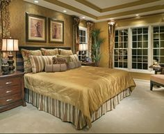 The dark golden bedroom adds a charm and a glamour to this decor.