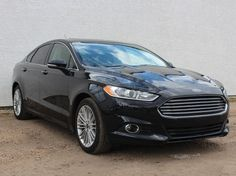 As good as new 2016 Ford Fusion with Auto-Park Feature! Other features: backup camera navigation sunroof premium sound XM radio   keyless entry Factory Warranty and more!  For price and other details visit: https://www.carcorneredmonton.com/inventory-used-vehicle-car-truck-suv.php?id=790