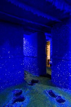 These are images from Seizure an installation by London-based artist Roger Hiorns. Hiorns covered the walls of an abandoned apartment with plastic and chicken wire pumped eighty-seven thousand liters of copper sulfate into the space and left. Months later, the remaining liquid was pumped back out of the flat, leaving shimmering surfaces of brilliant blue crystals throughout the installation. Mineral is Chalcanthite.