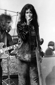 Singer Grace Slick of the Jefferson Airplane plays a guitar backstage at The Family Dog in Febuary 1970 in San Francisco, California. Description from gettyimages.co.uk. I searched for this on bing.com/images