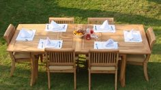 """Grade-A Teak Wood Luxurious Dining Set Collections (AB9): 7 Pc - 94"""" Rectangle Table and 6 Stacking Arm Chairs [**Click To See More Choices...] by TeakStation. $1589.99. Stackable chairs for easy storage. Dimension: 24"""" Width x 22"""" Depth x 35"""" Height. 7pc Set includes: 94"""" Double Extension Rectangle Table, 6 Stacking Arm Chairs. Table comes with 2"""" umbrella hole. Dim: 71"""" L(no extension) and 94"""" L(with extension), 40"""" W, 30""""H. Teak wood is an extremely dense course grai..."""