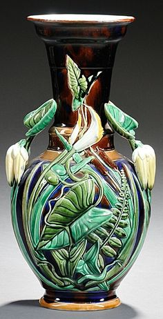 Sarreguemines Majolica Vase, France, late 19th century, heavily decorated with foliage and reeds to a dark blue ground, impressed mark, ht. 16 1/2 in.