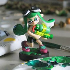 One of the earlier Inkling customs I created. I hardly remember working on this one, lol! The goggles are fairly simple on her, if I could go back I would definetely make some more detail.  #inklings #splatoon #amiibo #customamiibo #inklingamiibo #squidkid #inkling #nintendo #nintendofanart #splatoonfanart #woomy