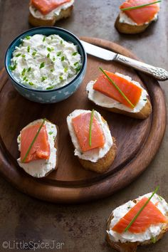 Smoked salmon goat cheese bruschetta with smoked salmon, whipped goat cheese, bruschetta, chives, and cream cheese. We made something similar in catering, but I can just take out the goat cheese and replace with cream cheese if you want on my bruschetta. Ours consisted of salmon, cream cheese and a slice of green onion. It looks fancier than this one too :)