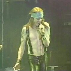 Axl Rose (slash is runnin' in the back ground haha) Oh my god he's so hot!