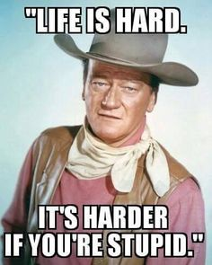 John Wayne - US actor wearing a tan leather waistcoat, a pink shirt and a white neckerchief, in a studio portrait, against a light blue background, circa Hollywood Stars, Old Hollywood, John Wayne Movies, John Wayne Quotes, Cinema Tv, The Lone Ranger, Evolution Of Fashion, Idole, Western Movies