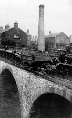 Lorry crash on Union Road bridge, showing Torr Top Mill chimney.