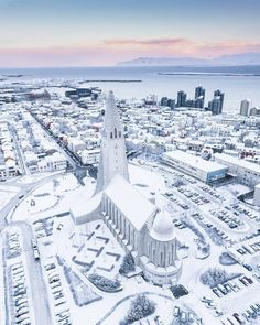 Reykjavik, the smallest capital of Europe in its full winter glory. In the centre of this picture you can see the famous Hallgrímskirkja church. Photo by the talented Places To Travel, Places To Visit, Inspired By Iceland, Iceland Adventures, Iceland Travel, Reykjavik Iceland, Visit Reykjavik, Beautiful Buildings, Winter Scenes