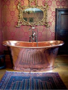 tudor copper bath from Athelhampton House a historical home in Dorset England. Bohemian style in use of colors and metallic finishes.