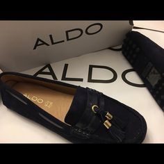 Brand new ALDO flats Navy blue. Never used. Size 8 women. Super comfortable cushioned inner sole. Suede leather outer and inner. Perfect for those long vacation walks but yet look classy. ALDO Shoes Flats & Loafers