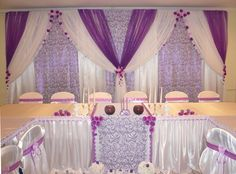 The blue light makes the white drape versatile in this setting purple voile over lavender patterned and white drapes party backdropsbackdrop ideaswedding junglespirit