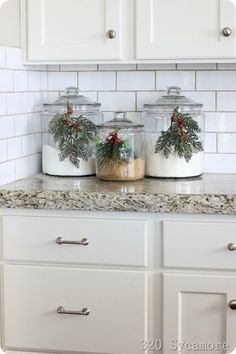 Christmas evergreens on your kitchen canisters - 320 Sycamore