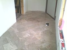 Installed marble floor, brick pattern on the diagonal.  Not yet grouted.