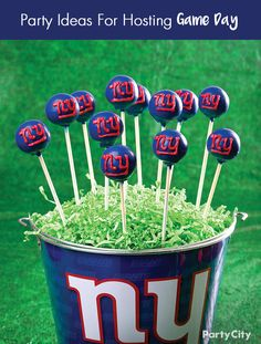 Gearing up with the latest football party supplies? Show even more team spirit with football party desserts everyone will enjoy! Start with a Galvanized Bucket that shows off your team's logo. Add Green Crinkle Paper Shreds, and arrange some cake pops decorated in the colors of your favorite NFL team. Be sure to check out our idea gallery for more sweet suggestions!