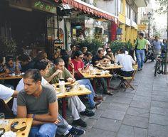 eating halva in a sidewalk cafe in Tel Aviv