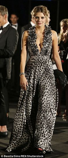 Wild thing: Mischa Barton looked stunning in a plunging leopard print dress which featured...