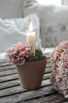 Dainty and sweet for a centerpiece or placed on dessert, cake, gift, guestbook signing, escort card tables. Small terra cotta pot with flowers and one taper candle.