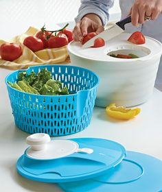 Salad Spinner Cutting Board and Salad Spinner. Just slip your slices directly into the salad. Rinse, spin, serve, and store.