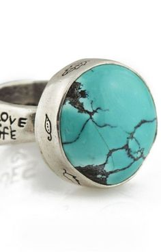 "Jes MaHarry Jewelry  |  ""Navajo ring"".  Hand set Turquoise in a sterling silver bezel and emblazoned with leaves. On the sterling band, a horse runs among clouds, hearts, flowers and stars and it is flanked with the sentiments: ""See Beauty"" and ""Love Life."" The sterling silver band graduates in size. ""True Love"" is inscribed inside the band. (Band width graduates from 3/16""-3/8"" - Sizes: 5-9. Stone measures 19mm across)."