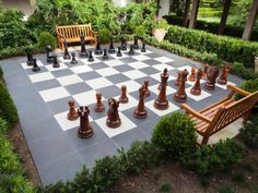 If you've got the space, a giant chess or checkerboard is a fun and functional backyard addition that will wow guests. Learn how to make your own using just concrete and sod.