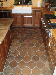 """I love the rustic look of this traditional kitchen. The floor is laid with Antique Terra Cotta Saltillo tile in the """"San Felipe"""" shape pattern."""