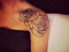 Beautiful black and white rose tattoo  Feminine placement Shoulder. 15 best places for women to get tattooed.