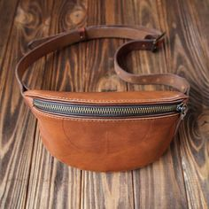 Brown Leather fanny pack perfect for traveling, festivals, concerts, events, shows, shopping, short walk, bike ride. Its amazing companion to travel any distance, work, school, gym. This fanny pack features a wide strap that wraps and buckles around the waist and small pouch that sits