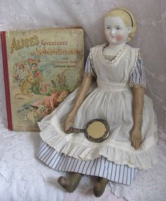 19th Century Alice Parian with Alice in Wonderland Antique Book and Antique Silver Looking Glass Dolls And Lace.com