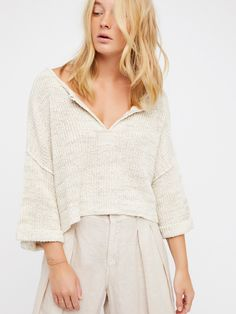 Daybreak Sweater   So effortless sweater featuring a knit design with a slightly cropped, slouchy fit.    * Soft V-neckline   * Fabric patch accents on front and back   * Rolled sleeve cuffs   * Subtle side vents
