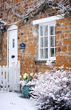 Snowy cottage looks so cozy. I imagine inside feeling the warmth of the fireplace and smelling soup on the stove.