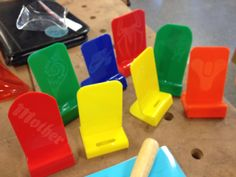Great skills-based project using off-cuts of cast acrylic to make mobile phone stands