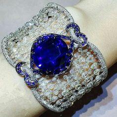 A 27.06 carat Oval Unheated Ceylon Sapphire Bracelet with diamonds.
