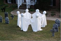 "Circle of Dancing Ghosts for Halloween  -------  For this yard decoration, you'll need six white sheets, 6 poles, tape, and wads of shopping bags to form heads (or 6"" styrofoam balls).  They are ghostly cool!"