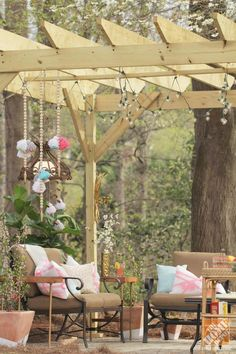 Here's a patio and pergola where one didn't exist before. Joni of Lay Baby Lay created an exquisite outdoor family room, complete with clever DIY decor. Click through for more gorgeous photos. (@Joni Lay / Lay Baby Lay)