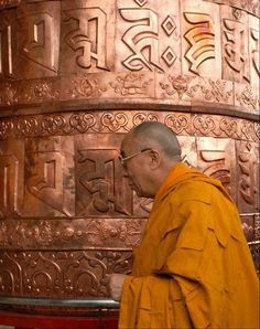 Dalai Lama and prayer wheel