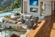 This new home, located high above the Sunset Strip in Los Angeles, California, has stunning views, an infinity edge pool, and plenty of outdoor entertaining spaces to enjoy.