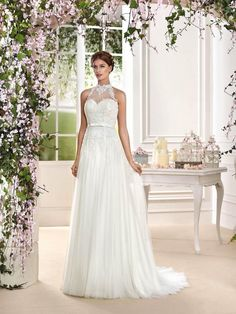 Halter wedding dress with a lovely cascading tulles skirt - Dress: Fara Sposa 2016 Collection